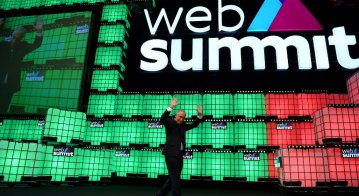 Portuguese President Marcelo Rebelo de Sousa waves after delivering the closing speech on the centre stage of the 2018 edition of the annual Web Summit