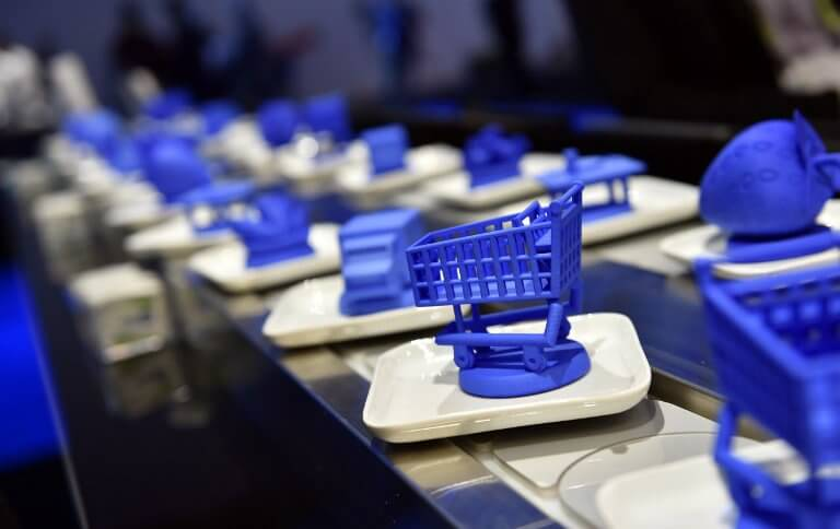 A conveyer belt with objects is used to demonstrate blockchain technology at the IBM booth at CES 2019