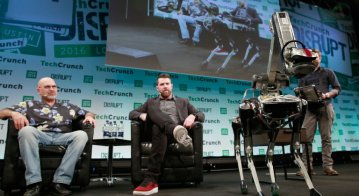 Marc Raibert, Founder of Boston Dynamics, TechCrunch Moderator Darrell Etherington and Boston Dynamics' Spot robot attend a Q&A during day 1 of TechCrunch Disrupt London at the Copper Box on December 5, 2016 in London, England.