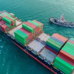 Container ship and Tuk boat going to sea port for logistics shipping , import export or transportation