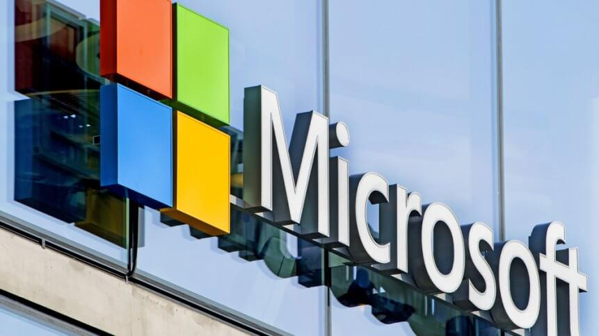 Microsoft logo company on the window facade of the new Microsoft headquarter, in Milan
