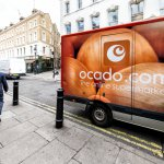 Ocado online store grocery shopping delivery supermarket sign on truck with red orange color in Covent Garden near SoHo