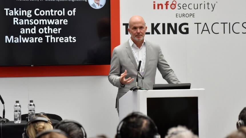 Presenter speaks at Infosec 2018.