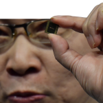 Richard Yu, head of Huawei's consumer business, presents a Kirin 990 5G chip set at the IFA
