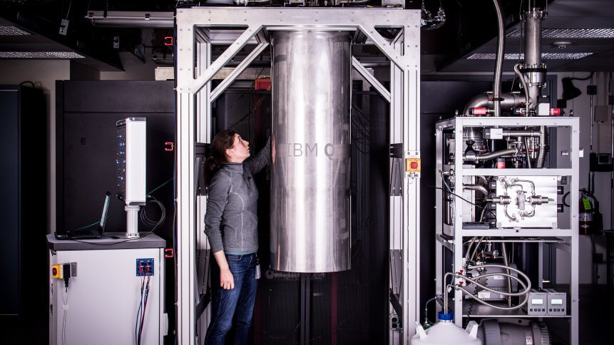 IBM Research Staff Member Katie Pooley examining a new prototype commercial quantum processor.