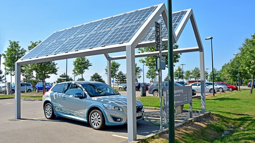An electric car charges from a solar energy charger in Sweden.