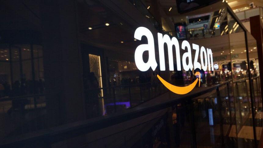 Amazon logo on black shiny wall in mall California