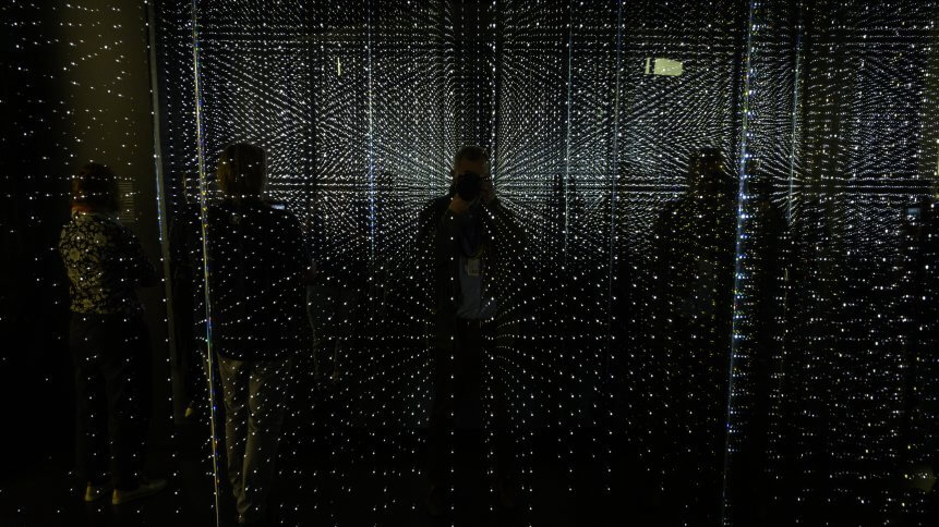 """Visitors check out an infinity chamber seeking to reproduce the atmosphere of a large data centre at the """"Futurium"""", House of Futures in Berlin"""