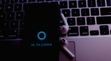 Smart phone with the Cortana logo is a virtual assistant created by Microsoft
