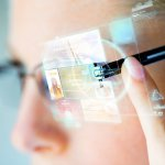 close up of woman in smart glasses with virtual screen