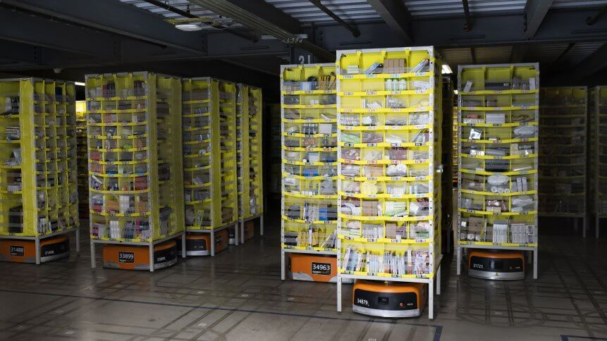 Hundreds of lawnmower-sized robots that move around shelving units in a closed field are seen during a tour of Amazon's Fulfillment Center.
