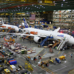 Unidentified Boeing employees continue work building a Boeing 787 jets at its Everett factory, including for Japanese airline All Nippon Airways